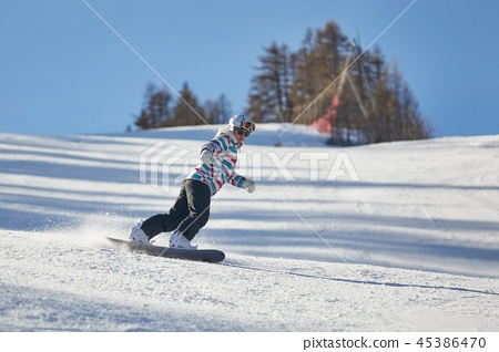 Female snowboarder on the slope 45386470
