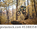Image of sportsman riding sports bike on track 45388358