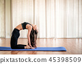 Young woman practice yoga in an gym studio. 45398509