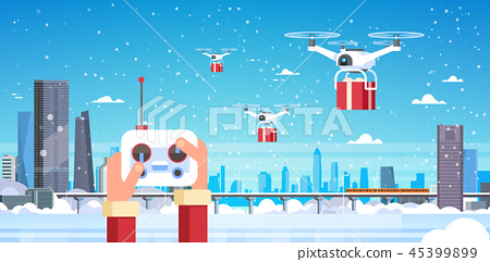 human hands hold controller drone delivery service over modern winter city monorail skyscraper 45399899