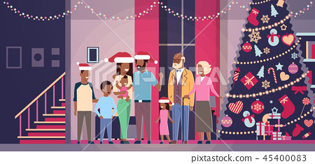 multi generation african american family standing together in house near decorated fir tree happy 45400083