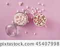 Marshmallows in mug and glass jar 45407998