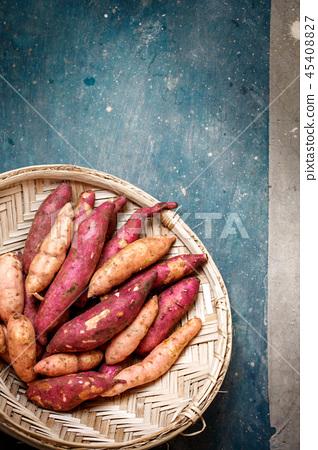 sweet potato in a wicker sieve, close-up 45408827