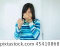 Asian woman suffering from eye pain 45410868
