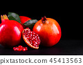 Ripe pomegranate fruits on the wooden background 45413563