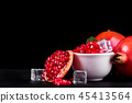Ripe pomegranate fruits on the wooden background 45413564