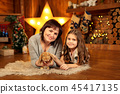 Family photo of mother and daughter laying 45417135