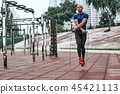 Muscular african man is skipping rope. Portrait of muscular young man exercising 45421113