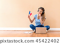 Young woman with French flag using a laptop computer 45422402