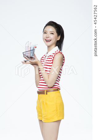 beautiful young woman shopping, sale concept photo. attractive young woman isolated. 112 45427562