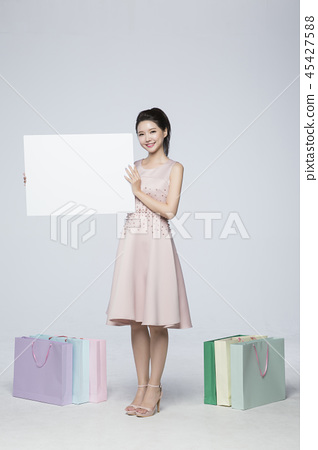beautiful young woman shopping, sale concept photo. attractive young woman isolated. 153 45427588