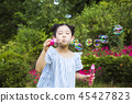 Cute little boy and girl harvesting together. Gardening, planting concept photo 351 45427823