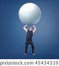 A small muscular athlete holds a large white volleyball ball on straight arms above himself. 45434310