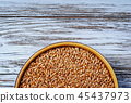 Raw grain in a plate 45437973