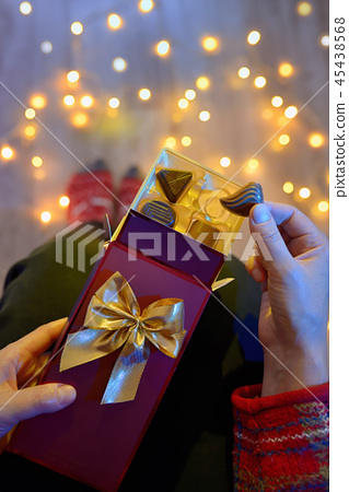 Woman Holding Chocolate Present 45438568