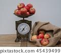On wooden background the nostalgic kitchen scale  45439499