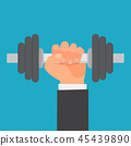 Hand of man holding a dumbbell. 45439890