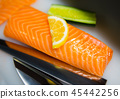 Salmon cutting preparing for cooking. 45442256