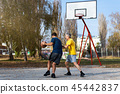 Father and son playing basketball in the park 45442837