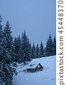 Winter landscape with wooden house in mountains 45448370
