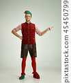 friendly man dressed like a funny gnome posing on an isolated gray background 45450799