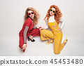 Two Gorgeous Girl in Fashion Outfit. Curly Hair 45453480