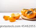 Sliced persimmon fruit  45462055