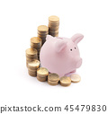 Piggy bank with stacks of coins over white  45479830