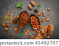 Cocoa powder and cacao beans on stone background. 45492707