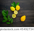 Fresh lemons and  lemons leaves. 45492734
