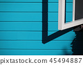 Blue wall with window 45494887
