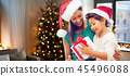 happy mother and daughter with christmas gift 45496088