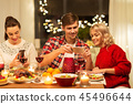 happy friends having christmas dinner at home 45496644