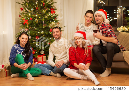 friends celebrating christmas at home 45496680