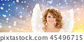 teenage girl with angel wings over snow 45496715