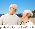 happy senior couple over venice beach background 45496932