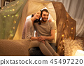 happy couple in kids tent at home 45497220