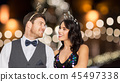 couple with christmas or new year party props 45497338