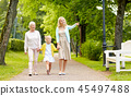 happy mother, daughter and grandmother at park 45497488