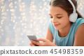 girl, smartphone, headphones 45498359