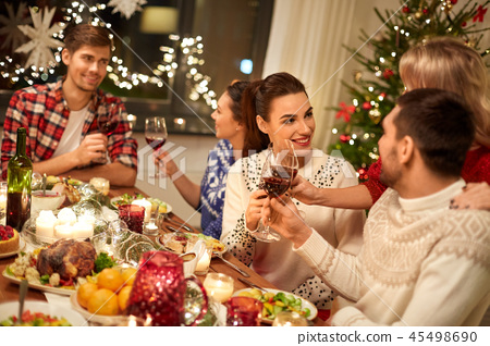 friends celebrating christmas and drinking wine 45498690