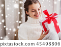 happy beautiful girl with christmas gift at home 45498806