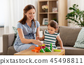pregnant mother and daughter with toy blocks 45498811