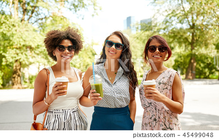 happy women or friends with drinks at summer park 45499048