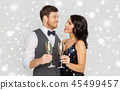 happy couple with champagne celebrating christmas 45499457