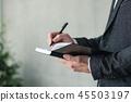man hand writing notebook business planning agenda 45503197