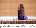 lavender essential oil bottle and fresh flowers for aromatherapy 45505652