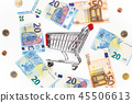Empty shopping cart with around various banknotes 45506613