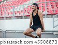 Handsome smiling man relax on stadium background 45508873
