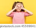 funny joyful playful girl look hand binoculars 45509641